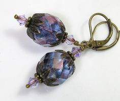 The main focus of these handmade vintage style earrings are large and lovely faceted firepolished Czech glass rounds in stunning amethyst purple with a luster finish. $20.50 #jewelry #vintagestyle #Swarovski #handmade #earrings