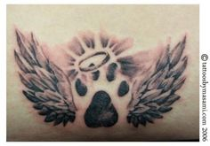 Cat memorial tattoo I like it with just paw print and halo