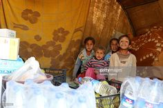 Children are seen the aid packages sent by Humanitarian Aid Foundation at new village which was established near Sajur River by the Syrian civilians escaping from Um A'amuda village of Al-Safirah district located in south of Aleppo, Syria due to the Assad regime's attacks in 2012, in northern Aleppo, Syria on October 19, 2016.