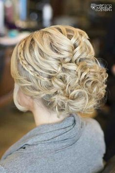 Curled hair with braid into bun.