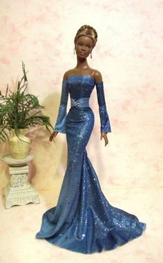 This Doll looks Anglo with a black tint. Blue Rain II - Esme looks lovely in this blue Barbie Gowns, Barbie Dress, Barbie Clothes, Barbie Style, Manequin, Diva Dolls, Dolls Dolls, Blue Ball Gowns, African American Dolls
