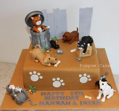 https://flic.kr/p/9abjhH | Alley cats and dogs cake | My cat-loving daughter shared a party with her dog-loving friend, so there was nothing for it but to make a cake with dogs and cats!  I was very much inspired by two fabulous cakes by Made by Gayle and the-icing-on-the-cake:  www.flickr.com/photos/allaboutcake/4913348720/  www.flickr.com/photos/the-icing-on-the-cake/4638873745/