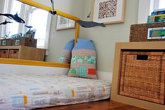 "interesting - Montessori Floor Bed: In the Montessori tradition, we avoid using devices that limit the child's independence and natural movement. For example, instead of using a crib to safely confine the baby, we turn the whole room into a ""crib"" (by completely child-proofing the room and closing off the entrance to the rest of the house with a gate)."