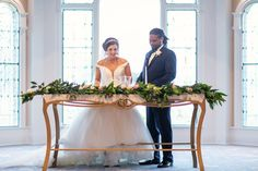 Unity Candle at Disney Fairy Tale Wedding Ceremony with long greenery alter floral arrangement