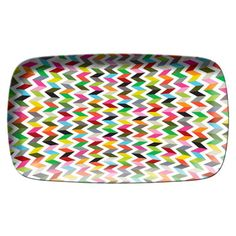 "This colorful zig zag rectangular platter is perfect for serving dessert  or little bites.  The design will easily mix with other patterns on your table or buffet. Measures 13.5"" x 8"" .    Made of 100% melamine, this kid-friendly tableware is dishwasher safe, high-heat resistant and shatter resistant. Not for microwave use."