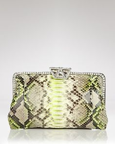 I love the color of this Clara Kasavina Pytthon Clutch. Great for a LBD.