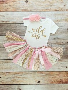 Pink and Gold Wild One Birthday Outfit with Headband/Pink and Gold Arrow Fabric Tutu/Baby Girl/Shirt with Age by MeadowsMarvels on Etsy https://www.etsy.com/listing/457109566/pink-and-gold-wild-one-birthday-outfit
