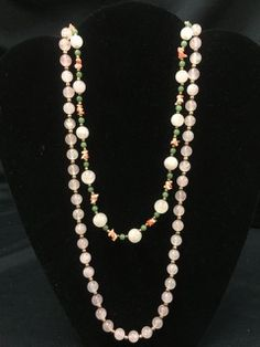 BEAUTIFUL LOT OF ROSE QUARTZ NECKLACES INCLUDES A 30 INCH NECKLACE WITH BRASS SPACER BEADS AND A 20 INCH NECKLACE WITH ADDITIONAL CORAL AND JADE ACCENT BEADS