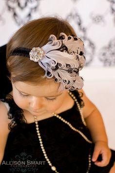 baby headband girls feather white with black edges bling rhinestone on ruffled elastic all sizes. $14.00, via Etsy.