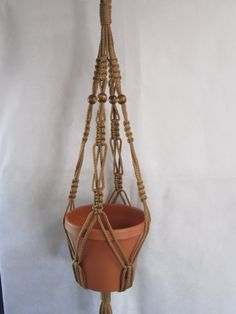 Macrame Plant Hanger Vintage Style 30 inch Cinnamon with BEADS sold by Macrame Design. Shop more products from Macrame Design on Storenvy, the home of independent small businesses all over the world. Macrame Plant Holder, Macrame Plant Hangers, Plant Holders, Plant Crafts, Vintage Fashion, Vintage Style, Macrame Design, Macrame Projects, Crochet Round