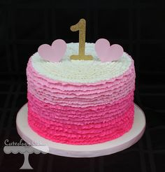 ombre ruffle cake with buttercream frosting. Gold one topper with pink hearts. 1st birthday cake www.facebook.com/i.love.cuteology.cakes