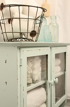 love it all... wire basket, bottles, cabinet
