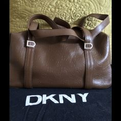 DKNY  Bag This is a cute barrel type bag with two straps.Authentic leather bag.  has dust bag. DKNY Bags