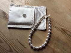 Swarovski pearls and bicones with Swarovski crystals. Sterling silver magnetic clasp