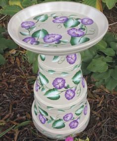 Using painted clay flower pots you can create some really interesting bird feeders which could also double as a painted bird bath. This is a fun and fast way to create a bird feeder that you can place on the ground, on your porch, or on a table.