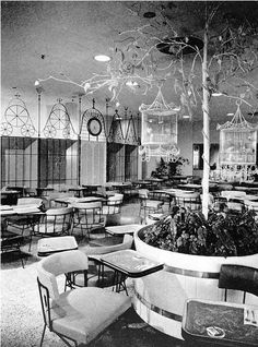 Lord + Taylor's famous restaurant The Bird Cage designed by Raymond Lowey. It was all pink and white - circa 1954