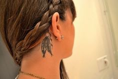 wow, cool placement of dream catcher feather tattoo... behind the ear near hair top of neck.... like hair adornment