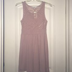 Forever 21 dusty rose/pink dress Purchased years ago, never worn. Size Large. Short length. A fun and flirty dusty rose/pink dress with eyelet lace design. Dress up with a statement necklace or dress down with a light cardigan for that perfect summer dress! Forever 21 Dresses Mini