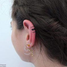 Indy Voet   Paris France / Brussels Belgium Hand-poked ear tattoo. tumblr: @indyvoet indyvoet@msn.com