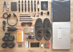 Collection of artifacts from a photographer/sketcher's carry on bag.