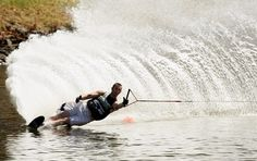 Slalom Water Skiing - that looks like my husband skiing at 38 off - REACH for it babe!
