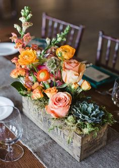 Try this unexpected take on a centerpiece: Plant your stems in aged, wood boxes. A mix of blooms and heights give this arrangement a relaxed, organic feel well suited for a rustic celebration. l TheKnot.com: