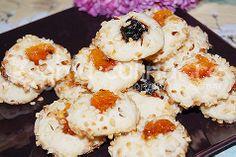 http://www.ghid-culinar.ro/retete-culinare/dulciuri-diverse/fursecuri-cu-gem-tavalite-in-alune.html