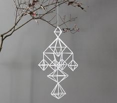 Geometric ornaments made from straws and string.