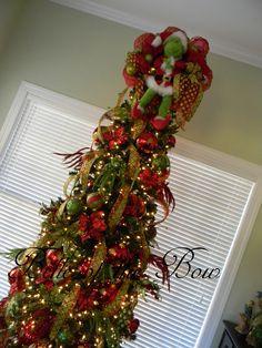 Large Grinch Wreath used as tree topper.  www.belleofthebow.com