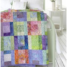 Quick and Easy Quilting Project Combine batiks and coordinating prints to create this soft, quick-to-sew bed-size quilt. There are no borders to sew, making it even easier.                                          Get instructions for the quick and easy quilting project.