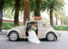 Let's be honest, I really don't let anyone drive our '67 Beetle. If you also own one of these gems, you understand my VW sickness. However, when our great friends Mike and Paula asked if it could be a part of their wedding, I felt very honored. And, what better a way to compliment a beautiful bride than a '67 Beetle. Congrats again, guys!  Photographer: Tanja Lippert