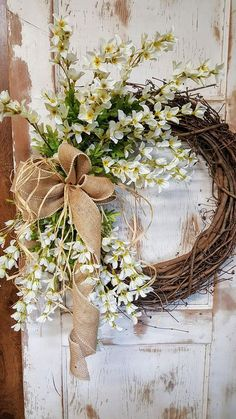 Rustic Grapevine wreath with burlap ribbon and white flowers. Rustic Grapevine wreath with burlap ribbon and white flowers. Forsythia Wreath, Grapevine Wreath, Wreath Crafts, Diy Wreath, Wreath Ideas, Wreaths For Front Door, Door Wreaths, Front Doors, Fall Wreaths