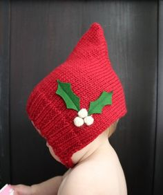 Baby elf hat! I am pretty sure you knit it on straight needles and then just single crochet or sew up the back. Anyone think there's a better way?