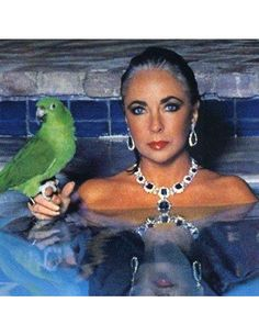 Elizabeth Taylor knows how to rock that Diamonds in a swimming pool with a parrot look.