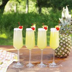 Piña Colada Mimosas This is the perfect drink to sip beachside (or poolside) this summer. The post Piña Colada Mimosas appeared first on Champagne. Fancy Drinks, Cocktail Drinks, Bar Drinks, Drink Bar, Bourbon Drinks, Alcohol Drink Recipes, Non Alcoholic, Refreshing Drinks, Mixed Drinks