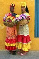 Two Cuban women in traditional dress, Plaza de la Catedral, Habana, Cuba (thumbnail)