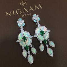 Opal, diamond and emerald earrings