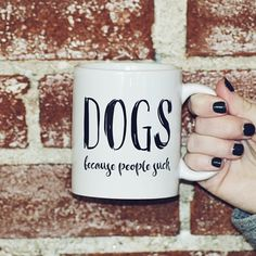 """Dogs Because People Suck - 15oz Coffee Mug. The perfect mug for that dog lover in your life. Or, if you're the dog lover, this mug is for you! Available in 15 oz. or 11 oz. Ceramic Coffee Mug (Please see separate listing for 11oz option) Product Material: Ceramic Microwave and Dishwasher Safe Mug Color: White Text reads: """"DOGS because people suck"""" Right or left handed - doesn't matter! This is a double-sided print. Same design on both sides. See images for more details. FRANK REGARD'S..."""