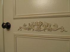Pantry doors, raised panel, antiqued, wooden appliques, antique bronze door knob.