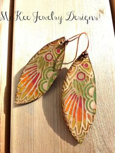 Copper and leather leaf earrings.
