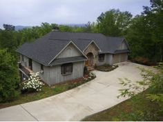 Find this home on Realtor.com  Front of the house with mountain views and golf course views.