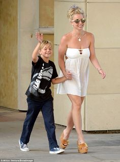Signature style: Britney Spears wore a little white dress to go shopping in Canoga Park, CA with her nine-year-old son Jayden on Monday
