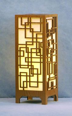 Decorative laser cut wood table lamp. Light is diffused by hand ...