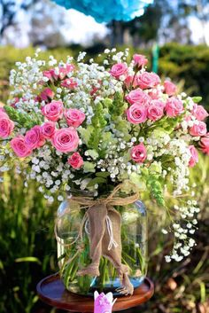 Vintage jar with pink roses and white baby's breath