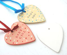 Make your own personalised hanging hearts as a gift for a new-born baby.  Basecoat with DecoArt acrylics. Stamp names using a rubber stamp and Versamagic ink.  Add dots using the end of a paint brush handle and varnish.