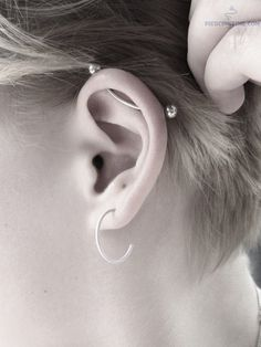 industrial piercing - I love the curve of this, softens the look.