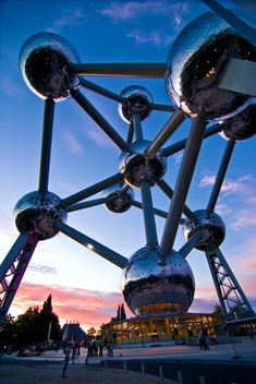 The Atomium is a building in Brussels originally constructed for Expo '58, the 1958 Brussels World's Fair. Designed by the engineer André Waterkeyn and architects André and Jean Polak,[1] it stands 102 m (335 ft) tall. Its nine 18 m (59 ft) diameter stainless steel clad spheres are connected so that the whole forms the shape of a unit cell of an iron crystal magnified 165 billion times.