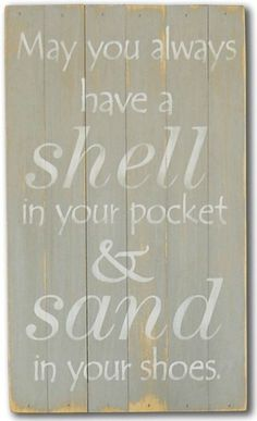 "Gray washed slat beach sign with off white simple quote """"May you always have a shell in your pocket and sand in your shoes"""". These wonderful beach house signs are made from rough slats pieced togeth"