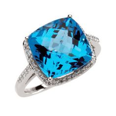 This blue topaz and diamond ring showcases a checkerboard cushion cut faceted blue topaz gemstone accented with pave set diamonds. The gemstone set in this blue topaz ring is a genuine Swiss blue topaz measuring approximately 12 x 12 mm. The diamonds set in this blue topaz ring are I1/HI quality and have a total weight of 1/4 of a carat. 1,179.00 USD