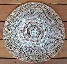 Round plastic yarn crochet rug made from grocery store used bags. I made a 5' by 5' square rug just out of tan grocery bags. People think it's sea grass. Best part 100% FREE!